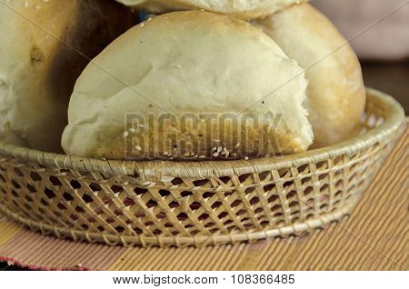 Small  loaf fresh household bread in the breadbasket
