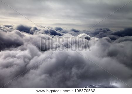 Top Of Off-piste Slope In Storm Clouds