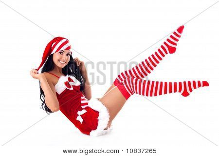 Female Santa Sits Lifted His Legs Up. Holidays Christmas And New Year.