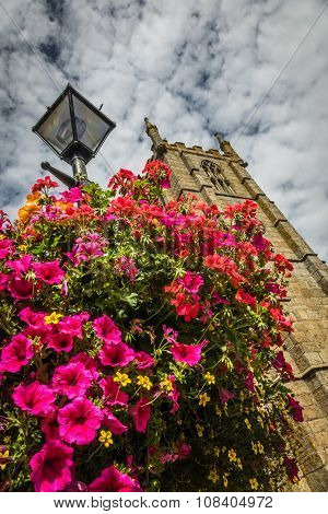 St Ia's Church clock tower and flowers