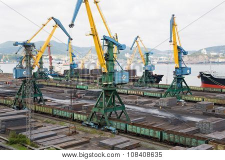 NAKHODKA, RUSSIA - CIRCA SEPTEMBER, 2015: Loading metal in cargo ship at the port of Nakhodka. It is the largest port in Russia, main export goods in port of Nakhodka are coal, oil, wood and metals