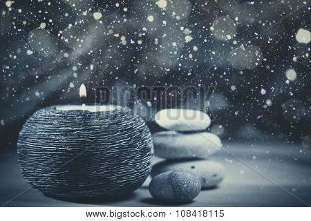 Abstract Christmas backgrounds with burning candle and snowfall