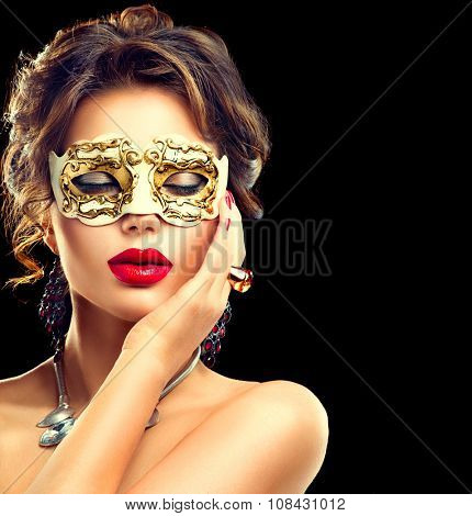 Beauty model woman wearing venetian masquerade carnival mask at party isolated on black background. Christmas and New Year celebration. Glamour lady with perfect make up and hairstyle