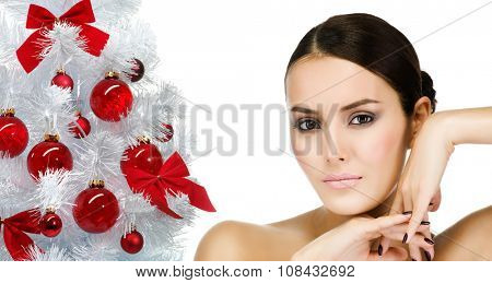 portrait of attractive  caucasian  woman brunette isolated on white studio shot christmas new year tree