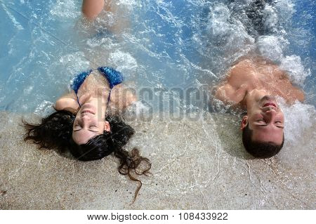 Couple In Jacuzzi Enjoying A Hydrotherapy Session