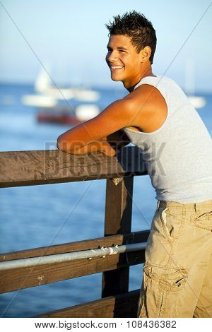 Young man standing on the pier