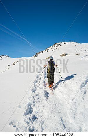 Alpine Ski Touring Towards The Summit