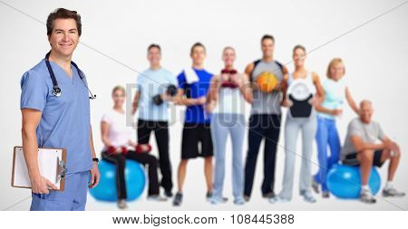 Smiling medical doctor man and group of fitness people.