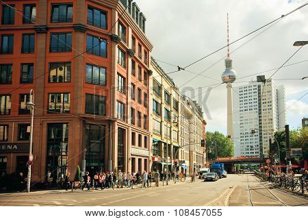 Rushing People On The Street With Famous Structure Of Television Tower