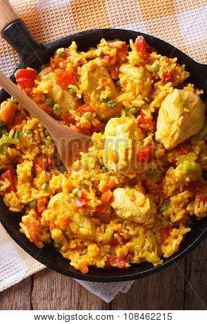 Hispanic Cuisine: Arroz Con Pollo Close Up In A Pan. Vertical Top View
