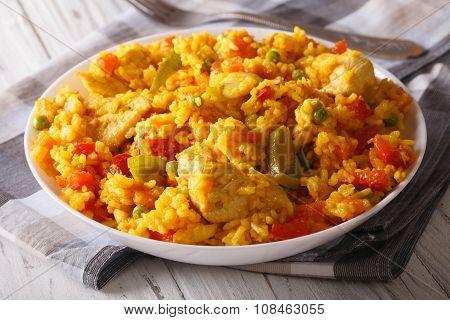Hispanic Cuisine: Arroz Con Pollo Close Up In A Bowl. Horizontal