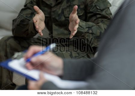Close up of psychologist analyzing military patient behaviour poster