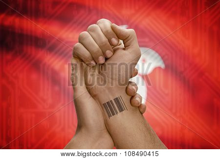 Barcode Id Number On Wrist Of Dark Skinned Person And National Flag On Background - Hong Kong