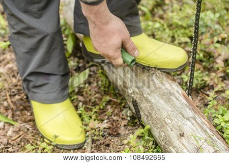 Tourist Sawing Using Portable Pocket Chainsaw