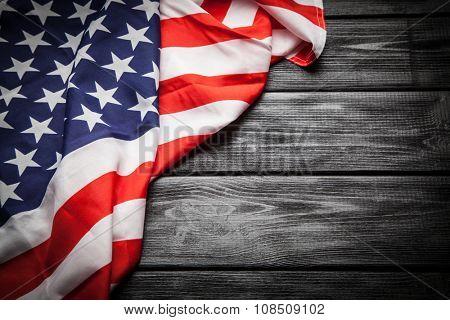 Flag of USA on dark wood background