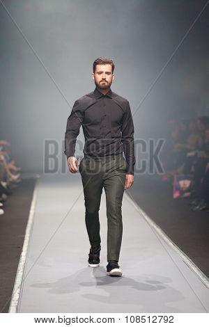 ZAGREB, CROATIA - OCTOBER 31, 2015: Fashion model wearing clothes designed by IK Studio on the 'Fashion.hr' fashion show