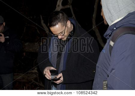 Ron Yacovetti Checks His Recording Device During Paranormal Investigation