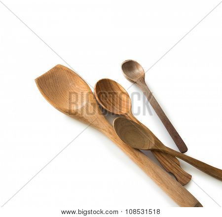 set of wooden kitchen spoons and other items on white background with textspace poster