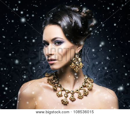 Young, beautiful and rich woman in jewels of platinum and stones over winter Christmas background poster