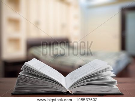 open book on old wooden table in the bedroom