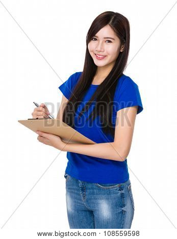 Asian Woman write on clipboard poster