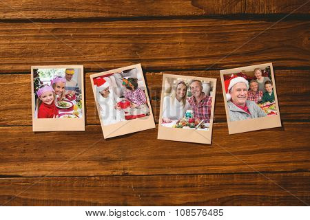 Instant photos on wooden floor against little girl and mother in party hat smiling at camera