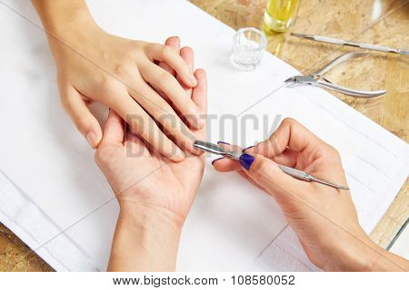 Cuticle pusher tool in nails salon woman hands treatment poster
