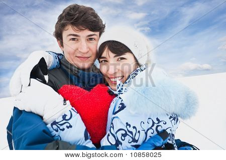 Smiling Girl In Blue Embrase Red Heart And Her Friend