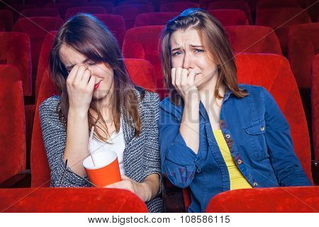 The spectators sitting in the cinema and watching movie. Concept of a variety of human emotions. poster