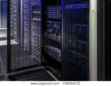 room with rows of server hardware in the data center