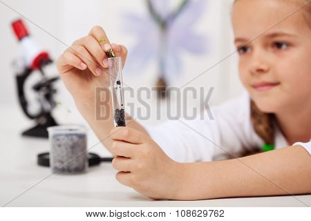 Young student in elementary school science class - study nature