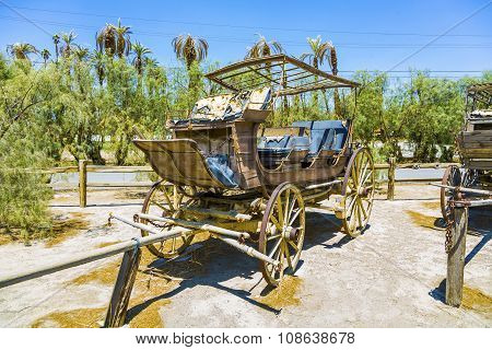 DEATH VALLEY, USA - JUNE 4, 2012: old historic stage wagons at the ranch under blue sky in the Furnance creek farm in death valley
