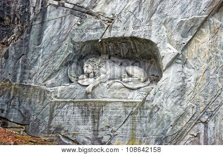 Dying Lion monument a sculpture in Lucerne (Switzerland) carved in the rock to honor Swiss Guards who were massacred during the French Revolution when revolutionaries stormed the Tuileries Palace poster