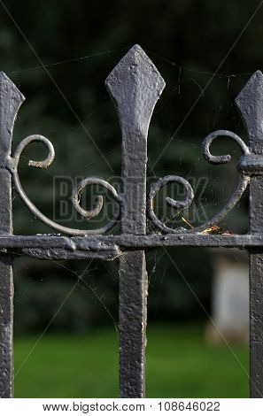 Black metal spiked decorative wrought iron fence at Holywell Cemetery in Oxford England. poster