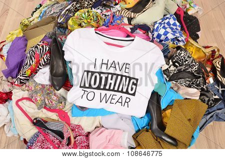Big Pile Of Clothes Thrown On The Ground With A T-shirt Saying Nothing To Wear.