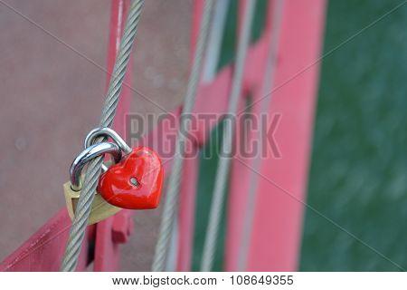Red heart shaped locket and padlock