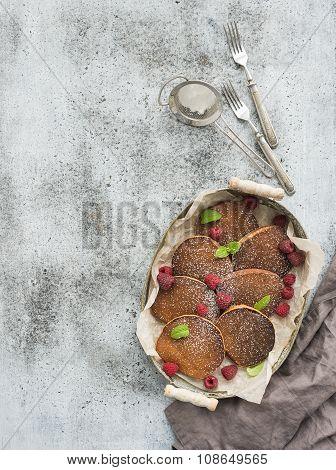 Breakfast set. Homemade buckwheat pancakes with fresh raspberry in  serving tray, kitchen napkin