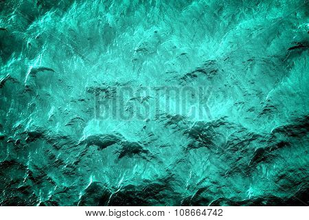 Blue water with sun reflections background texture high contrasted with vignetting effect poster