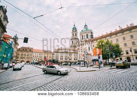 Car cross the tram tracks on the street Malostranske namesti in