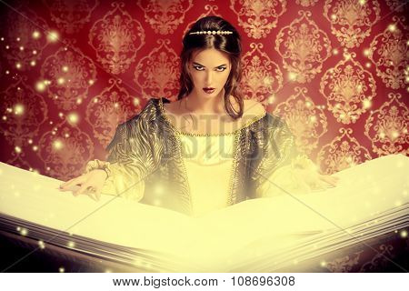 Fairy beautiful witch reads magic book of spells. Vintage style. Renaissance. Barocco. Halloween.