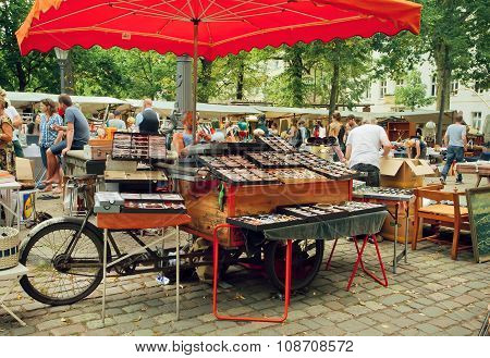 Crowded Flea Market With Creative Stands Of Vintage Glasses And Merchandise
