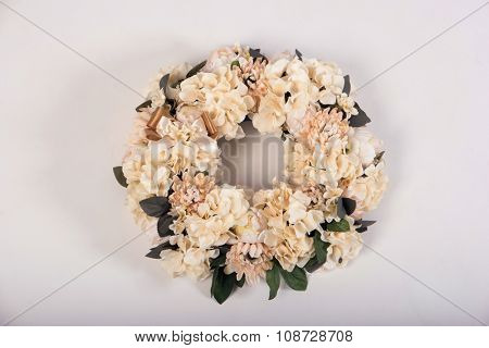 Artificial flowers wreath isolated on white