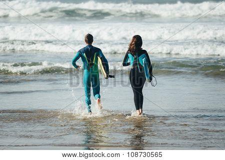 Happy Healthy Bodyboard Surfing Couple
