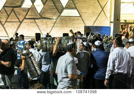 Men Dance With Bible Scrolls During The Ceremony Of Simhath Torah. Tel Aviv. Israel