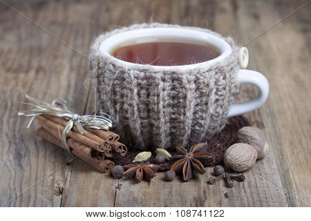 Cup Of Hot Spiced Tea  And Spices Around.
