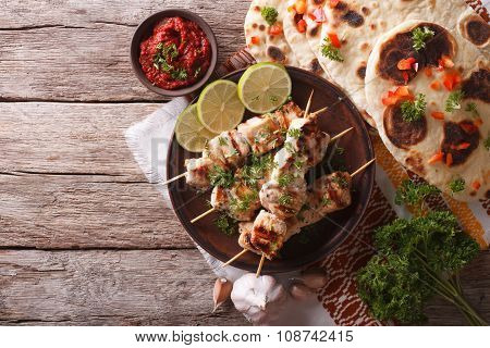 Chicken Tikka On Skewers, Flat Bread And Chutney. Horizontal Top View