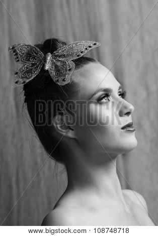 Black and white potrait of lovely woman with butterfly hairclip