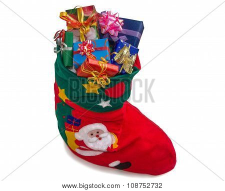 Christmas Stocking With Gifts Isolated Over White.