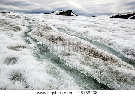 Two Parallel Water Stream Flowing In The Middle Of The Glacier In The Mountains