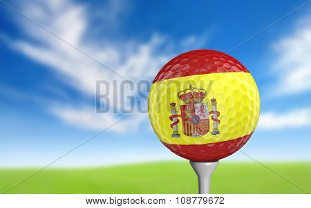 Golf ball with Spain flag colors sitting on a tee